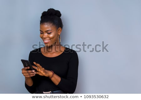 woman touching beads and smiling Stock photo © chesterf