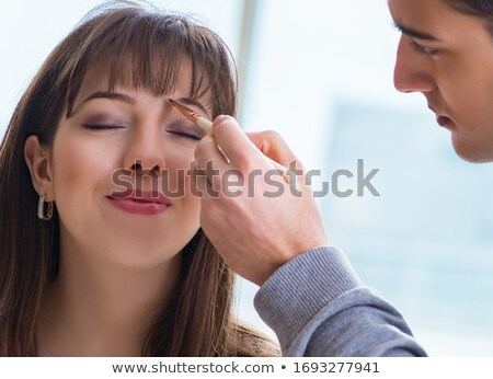 young attractive woman makeup eyebrow powder shadow applying Stock photo © juniart