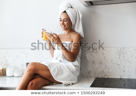 Stock photo: Beautiful young girl in a bath towel