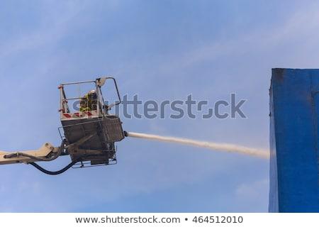 Fireman on an extended boom Stock photo © Hofmeester