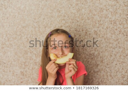 Stock photo: Beautiful girl with ripe melon