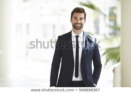ビジネスマン 笑みを浮かべて 肖像 企業 立って 垂直 ストックフォト © bmonteny