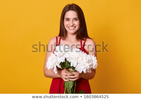 Femininity. Sincere Brunette with White Peony Stock photo © gromovataya