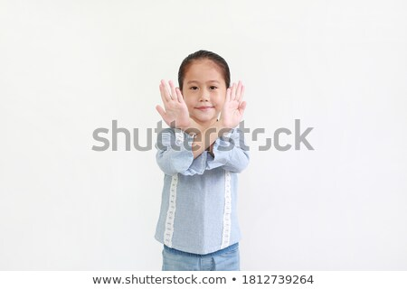 Pretty girl with crossed fingers Stock photo © Aikon