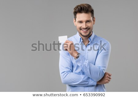 Young Man Holding Blank Visiting Card Stock photo © AndreyPopov