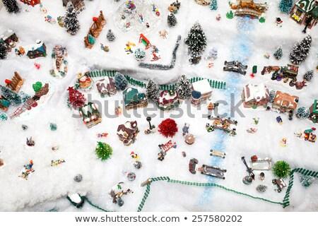 miniature christmas village under xmas tree stock photo © aetb