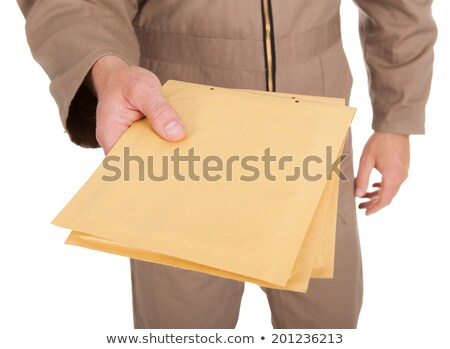 Midsection Of Postman Holding Envelopes Stock photo © AndreyPopov