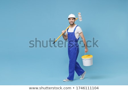 Young man with paint brush Stock photo © fuzzbones0
