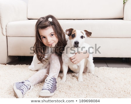 cute little girl with her puppy on rug stock photo © wavebreak_media