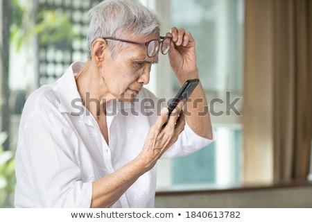 Blurred woman eyesight focus test Stock photo © roboriginal