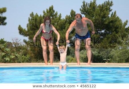 nő · férfi · gyermek · medence · víz · család - stock fotó © Paha_L