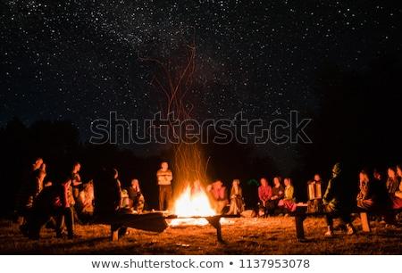Insanlar etrafında şenlik ateşi örnek gökyüzü adam Stok fotoğraf © adrenalina