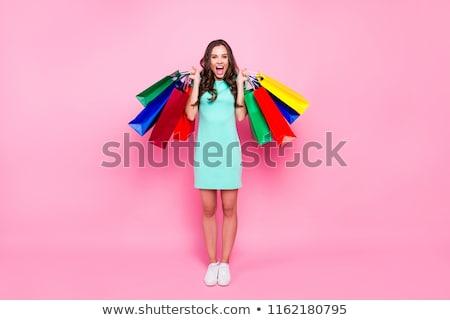 楽しい 女性 長い 黒い髪 ショッピングバッグ ストックフォト © deandrobot