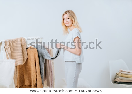 young blonde choosing what to put on stock photo © konradbak