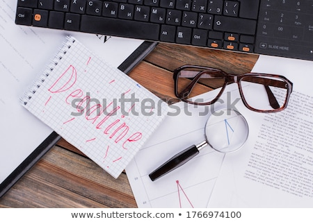 deadline word and office tools on wooden table stock photo © fuzzbones0