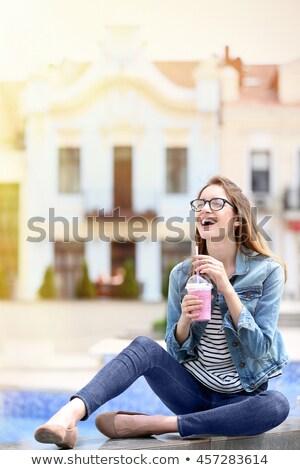 çekici kız oturma çeşme kız pembe elbise Stok fotoğraf © filipw