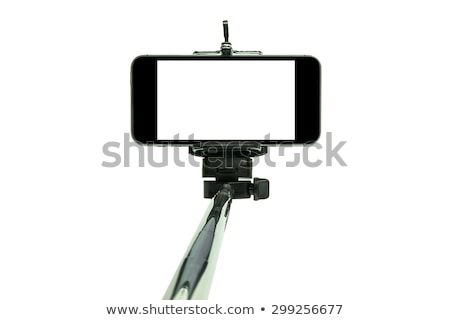 Selfie stick and smart phone Stock photo © magraphics