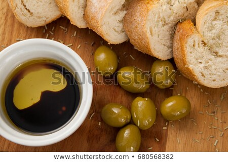 Close up of olives with bread and oil in container Stock photo © wavebreak_media