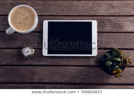 Digital comprimido café pote planta relógio de bolso Foto stock © wavebreak_media