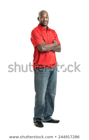 Smiling african man standing with arms folded Stock photo © deandrobot