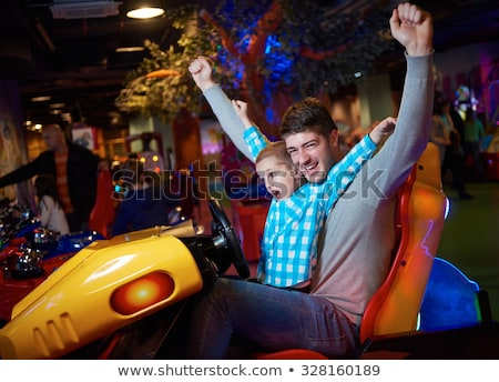 Family playing video games with wheel Stock photo © IS2