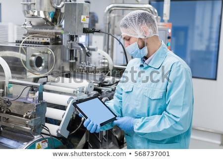 scientist show empty tablet near steel machine Stock photo © Traimak