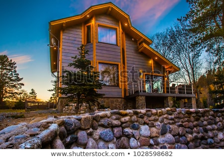 Modern stone cottage in forest Stock photo © orensila