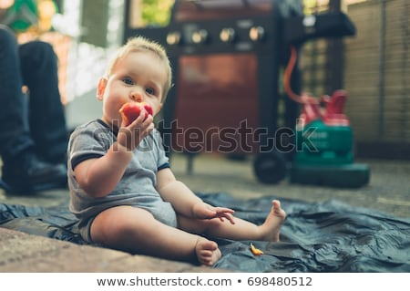 a boy eating a nectarine stock photo © is2
