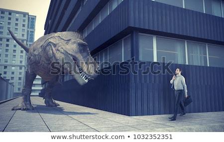 Empresário caminhada cidade dinossauro espera abstrato Foto stock © orla