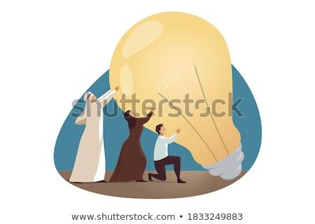 Arab üzletember tart ötlet villanykörte üzletasszony Stock fotó © studioworkstock