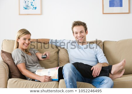 A woman reclining on a sofa Stock photo © IS2
