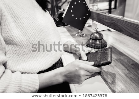 Couple handing passports to receptionist Stock photo © IS2