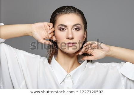 Androgynous man posing against grey background Stock photo © wavebreak_media