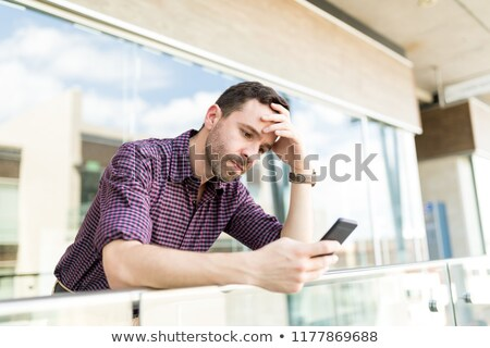 Worried man receiving bad news on phone Stock photo © ichiosea