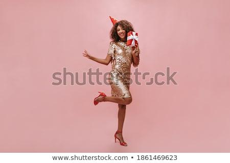 Tam uzunlukta fotoğraf güzel yetişkin kadın kıvırcık saçlı Stok fotoğraf © deandrobot