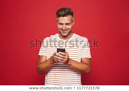 Afbeelding kaukasisch man gestreept tshirt glimlachend Stockfoto © deandrobot