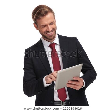 Ritratto ridere imprenditore guardando verso il basso tablet piedi Foto d'archivio © feedough
