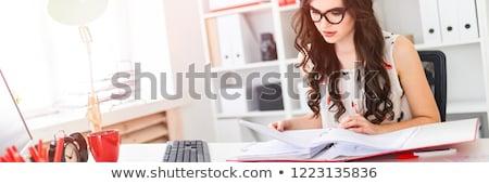 młoda · dziewczyna · okulary · tabeli · biuro · farbują · strony - zdjęcia stock © traimak