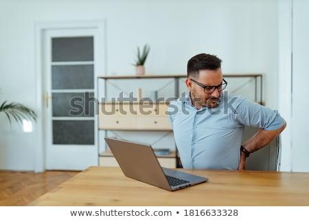 Uomo mal di schiena primo piano seduta divano mano Foto d'archivio © AndreyPopov