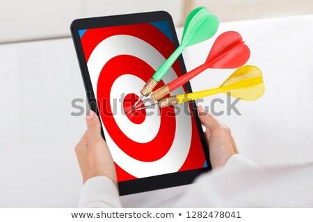 Emberi kéz tart digitális tabletta darts cél Stock fotó © AndreyPopov