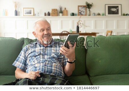 Person Doing Online Shopping On Tablet Stock photo © AndreyPopov