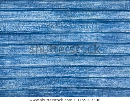 Old folk wooden background with horizontal boards painted in blue stock photo © bogumil