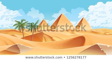 Pyramids in sand Stock photo © Givaga