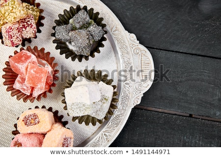 set of various turkish delight in bowl on metal tray stock photo © illia