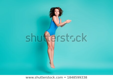 Below Water Photo Of Woman Swimming In Pool Stock photo © AndreyPopov