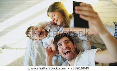 familie · sofa · cute · woonkamer · man - stockfoto © dolgachov