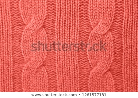 close up of knitted fabric in living coral color Stock photo © dolgachov