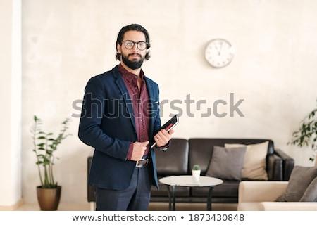 business · twee · jonge · collega's · mobiele · telefoon - stockfoto © pressmaster
