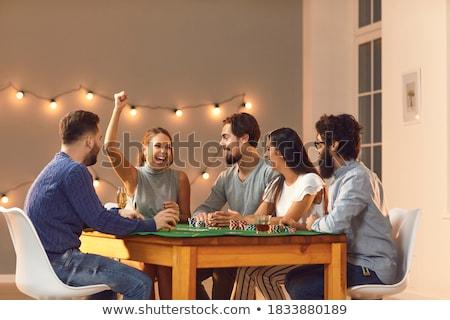 Arkadaşlar iskambil kartları oyun ev akşam dostluk Stok fotoğraf © dolgachov