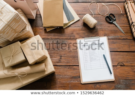 Checklist paper, pen, packed boxes, threads, scissors and stack of notepads Stock photo © pressmaster